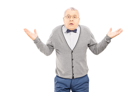 baffled: Confused senior man gesturing with hands isolated on white background Stock Photo