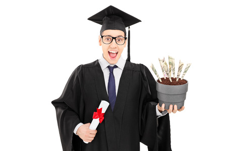 Male graduate student holding a diploma and flowerpot with US dollars in it isolated on white background photo