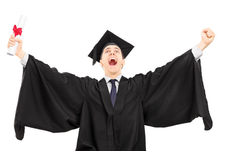 overjoyed: Overjoyed college graduate holding a diploma and gesturing happiness isolated on white background
