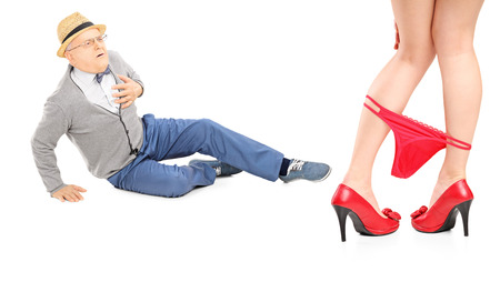 Senior gentleman looking at woman with her panties down and experiencing heart attack isolated on white background