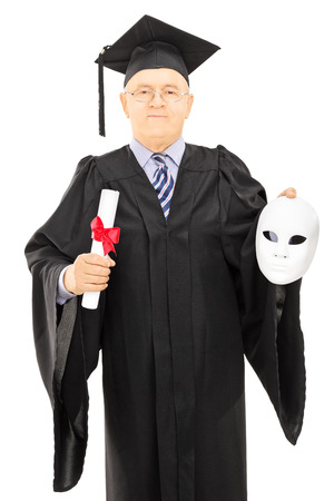 Mature man in graduation gown holding diploma and a theater mask isolated on white background photo