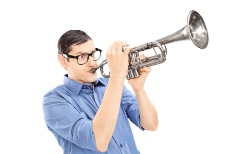 trumpeter: Young male trumpeter playing the trumpet isolated on white  Stock Photo