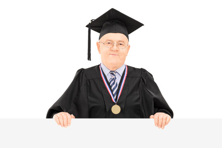 dean: Male university dean posing behind blank panel isolated on white  Stock Photo