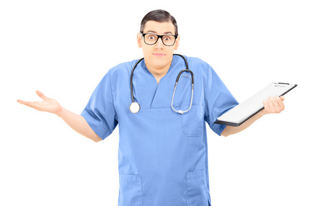 Confundido médico hombre haciendo un gesto con las manos aisladas en blanco Foto de archivo - 25860056