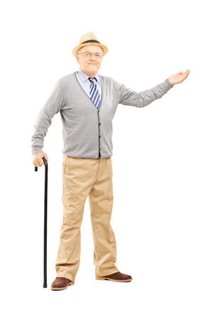 Full length portrait of an old man with cane gesturing with hand isolated on white