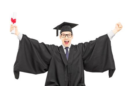 overjoyed: Overjoyed male student celebrating his graduation isolated on white