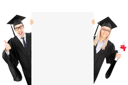 Two college students standing behind blank panel and gesturing success isolated on white background photo