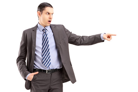 firing: Angry businessman pointing with his finger, isolated on white background