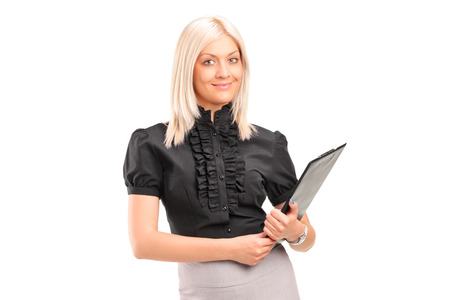 Blond businesswoman holding a clipboard isolated on white background