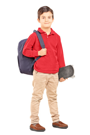 Full length portrait of a male kid with backpack and skateboard isolated on white background photo