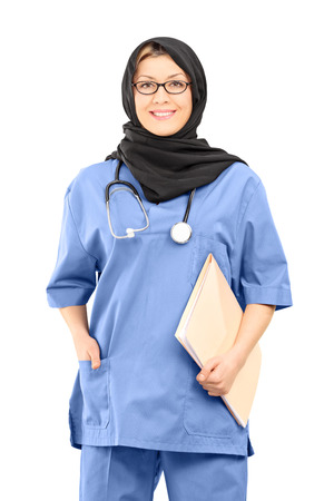 Muslim female doctor holding papers isolated on white background photo