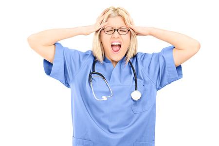 freaked: Shocked female doctor screaming isolated on white background