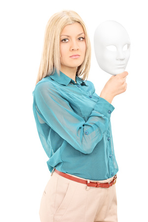 Young actress holding a theater mask isolated on white background photo