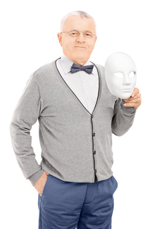 Senior man holding a theater mask isolated on white background photo
