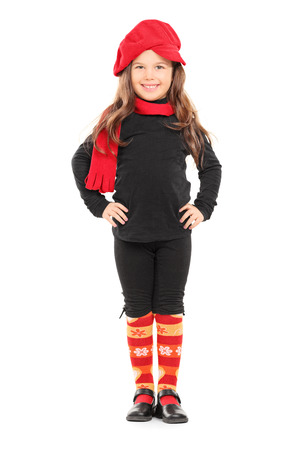 Full length portrait of a fashionable little girl with red beret isolated on white background photo