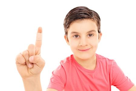 bruised: Little kid showing his bandaged finger isolated on white  Stock Photo