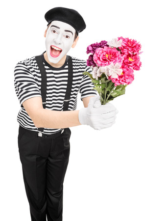 Male mime artist holding a bouquet of flowers isolated on white  photo