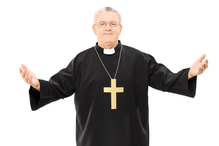 Mature reverend in black mantle with open hands isolated on white  photo