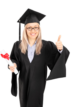 Young female student holding a diploma and giving thumb up isolated on white  Stock Photo - 26352733