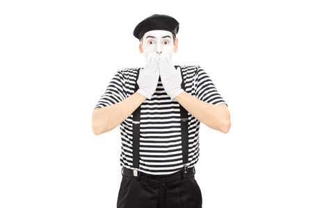 disbelief: Shocked mime artist standing in disbelief isolated on white background