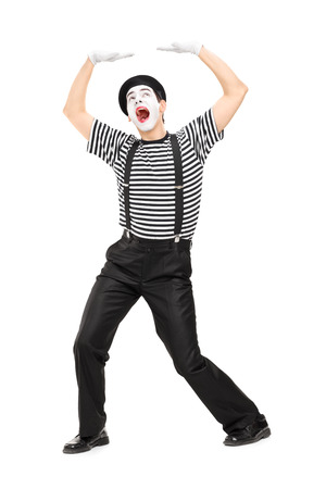 simulate: Mime artist simulate carrying something over his head isolated on white background Stock Photo