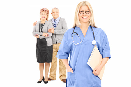 Mature couple posing behind female doctor isolated on white background photo