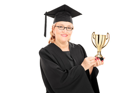 Mature female graduate student holding a gold cup isolated on white background Stock Photo - 26719985
