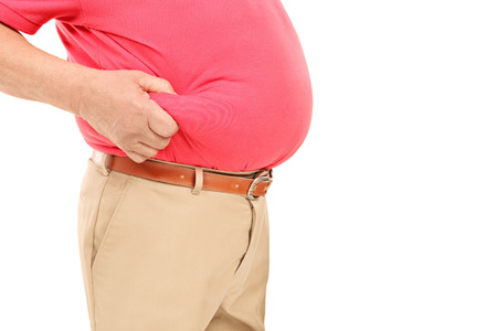 Studio shot of a man with big belly isolated on white background