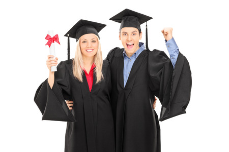 Male and female student celebrating their graduation isolated on white background Stock Photo