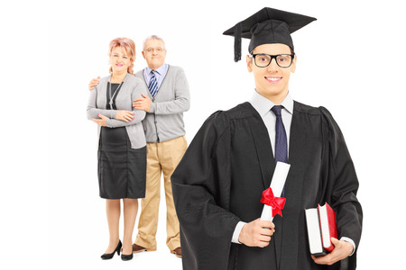 Studio shot of a college graduate and his proud parents isolated on white background photo