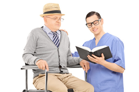 Male nurse reading to an elderly gentleman isolated on white background photo