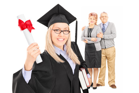 Studio shot of a female graduate student and her proud parents isolated on white background photo