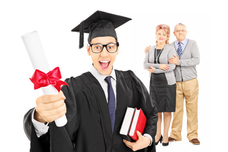 Studio shot of a male college graduate and his proud parents  isolated on white background photo