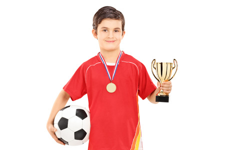 junior soccer: Football player holding a golden cup isolated on white background Stock Photo