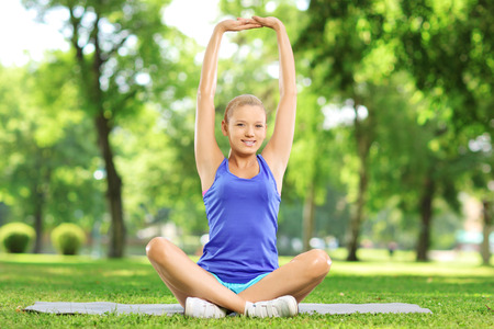 excercise: Young woman exercising in a park on a sunny day
