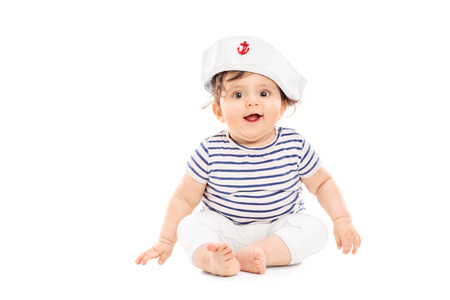 Cute baby girl with sailor hat isolated on white background photo