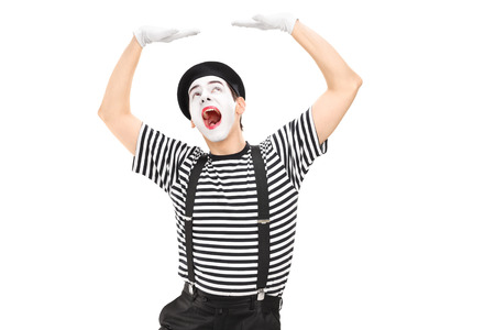 simulate: Mime artist simulate carrying something over his head isolated against white background Stock Photo