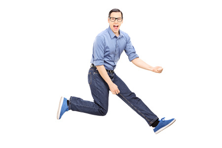 air guitar: Young man doing an air guitar jump isolated on white background