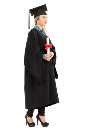 Full length portrait of a female graduate holding a diploma isolated on white background photo