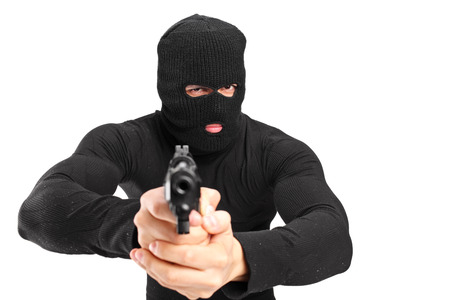 Man with a mask holding a gun isolated on white background photo