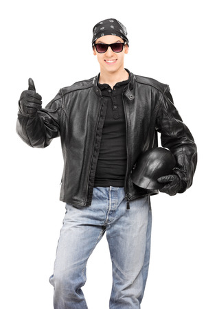 posing  agree: Biker giving thumb up isolated on white background