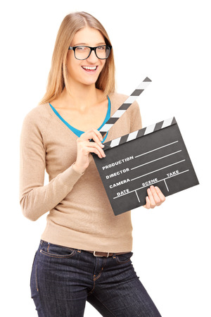 directors cut: Young woman holding a movie clap isolated on white background Stock Photo