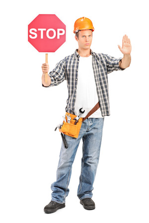 road worker: Construction worker holding a stop sign isolated on white background Stock Photo