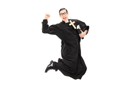 Excited male priest jumping with joy isolated on white background