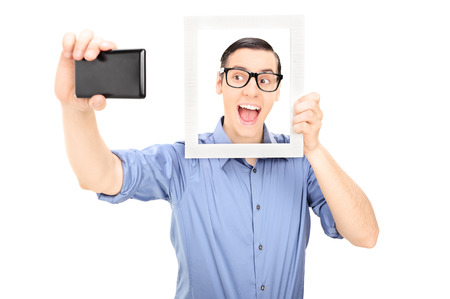 selfie: Man taking a selfie and holding a picture frame isolated on white background
