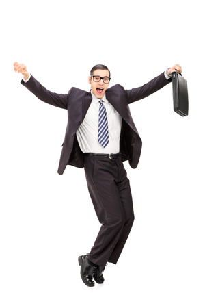 Full length portrait of a happy businessman dancing isolated on white background photo