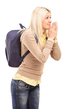 eagerly: College girl eagerly anticipating something isolated on white background