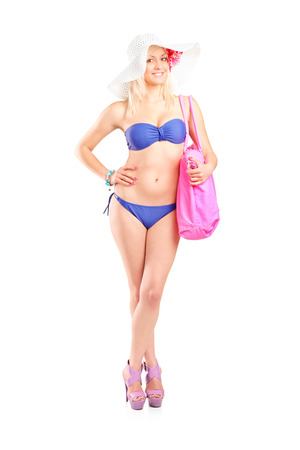 Young woman in bikini posing isolated on white background photo