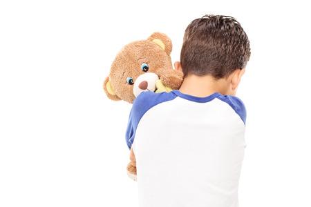 teddybear: Little boy hugging a teddy bear isolated on white background