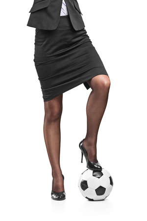 stockings heels: Businesswoman with football under her foot isolated on white background
